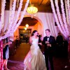 The bride and groom were welcomed into the cocktail reception with a burst of gold confetti!